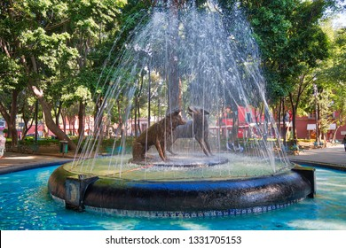 Coyoacan, Mexico City, Mexico-20 April, 2018: Drinking coyotes statue and fountain in Hidalgo Square in Coyoacan