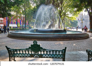 Coyoacan, Mexico-22 April, 2018: Central Coyoacan park with 3 Coyotes fountain on a weekend