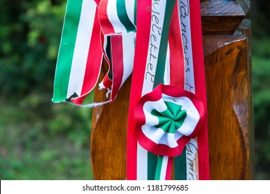 Cozmeni , Romania- 17 September 2018: Hand carved wooden post  with cockade in Memorial Park dedicated to heroes who died in Hungarian Revolution of 1848.
