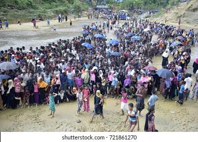 COZ'S BAZAR, BANGLADESH - SEPTEMBER 25, 2017: Myanmar's minority rohingya people wait in a queue to receive tram at Balukhali rohingya camp, Ukhiya in Coz's Bazar Bangladesh on September 25, 2017.