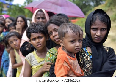 COZ'S BAZAR, BANGLADESH - SEPTEMBER 25, 2017: Myanmar's minority rohingya people wait in a queue to receive tram at Balukhali rohingya camp, Ukhiya in Coz's Bazar Bangladesh on September 25, 2017.
