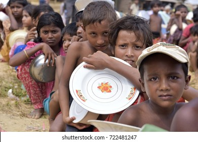 COZ'S BAZAR, BANGLADESH - SEPTEMBER 26, 2017: Rohingya Muslim children, who crossed over from Myanmar into Bangladesh, wait to receive free food during distribution by Turkish Embassy, Balukhali camp