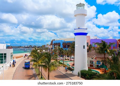 COZUMEL, MEXICO - APRIL 4, 2008: Beautiful quay with white lighthouse attracting thousands of tourists to visit famous shops and restaurants.