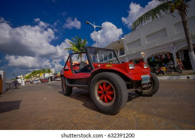 COZUMEL, MEXICO - MARCH 23, 2017: Colorful Red Jeep car, some tourist rent it to visit the most attractive places around the beautiful Cozumel, very useful for Stoned roads where convencional cars can