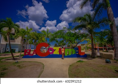 COZUMEL, MEXICO - MARCH 23, 2017: Plaza located in dowtown in the colorful Cozumel. with a colorful informative sign
