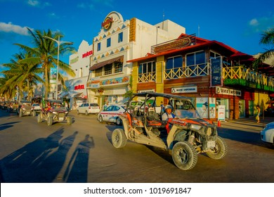 COZUMEL, MEXICO - NOVEMBER 09, 2017: Unidentified people driving a car in the city of Cozumel, surrounding of many stores in downtown