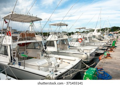 COZUMEL,MEXICO-JULY 20,2013 :Row of Boats used on fishing activities and tourism are parking at the marina in Cozumel Island, located at Mexican Caribbean.