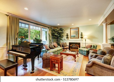 Cozy American classic living room interior design with piano and comfortable green sofa set. Northwest, USA