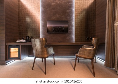 Cozy armchairs in luxury home or hotel interior