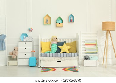 Cozy baby room interior with crib and toys