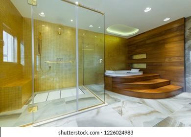 Cozy bathroom interior with shower cabin