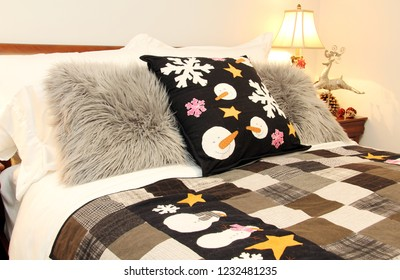 Cozy Bed decorated with snowman cushions for Christmas.