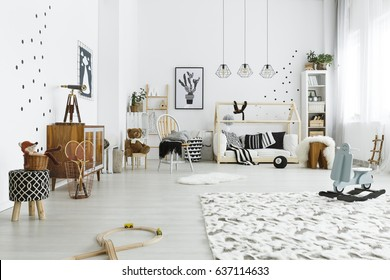 Cozy black and white baby room in scandinavian style