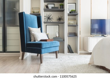 cozy blue chair with set of pillows in classic style bedroom, interior decoration design concept