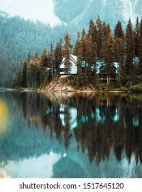 Cozy cabins in a forest on a little island at Emerald Lake in Yoho National Park in Canada.
