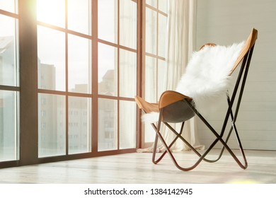 Cozy chair in front of panoramic window with city view sunset time light sunny conceptual. Concept new home flat waiting you, empty space new luxury modern apartments penthouse