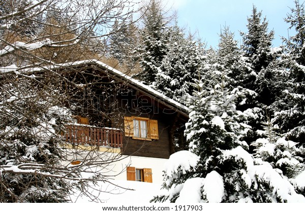 Cozy Chalet with Snowy Pine Trees