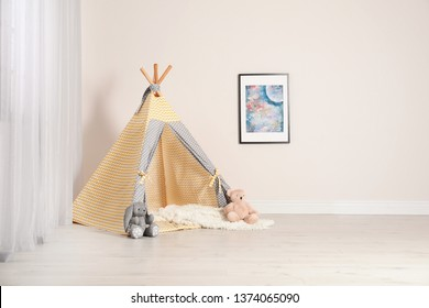 Cozy child room interior with play tent near window