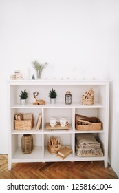 Cozy children room. A shelf with toys. New Year festive interior. Christmas decorations. Holiday concept. Scandinavian style