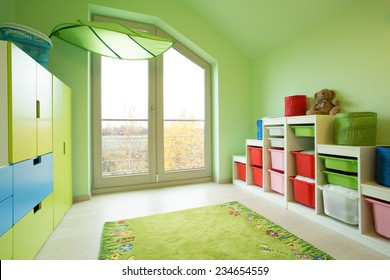 Cozy child's room with green painted walls