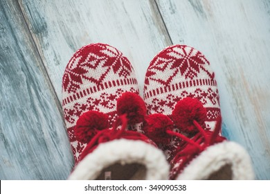 Cozy Christmas slippers on vintage wooden floor