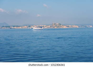 Cozy, colorful houses on the island of Corfu and the fortress, an excellent holiday destination on beautiful island, Ionian sea in Greece