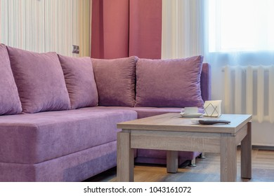 Cozy comfortable new sofa near table in modern room
