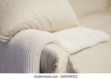Cozy couch detail with white throw - minimalism home concept