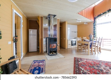 cozy decorated interior, big bright windows and glass door, fire place and xmas decor.