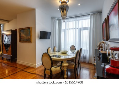 cozy dining room with decoration natural light, bright wall and hardwood floor with kitchen elements