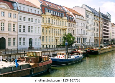 Cozy downtown Mitte on the Spree channel with old boats on it in Berlin, Germany