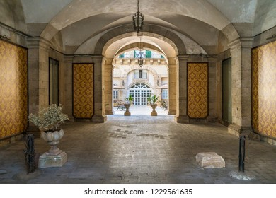 A cozy and elegant entrance in an historic palace of Siracusa old town (Ortigia). Sicily, southern Italy. July-25-2018