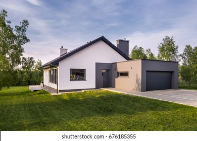 Cozy family house with garden and garage, outdoors