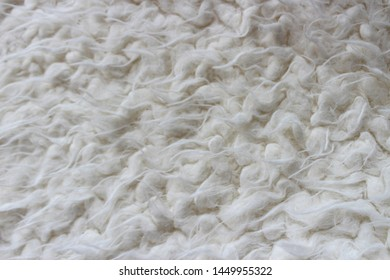 Cozy fluffy background in cream tones. Fur and pile.