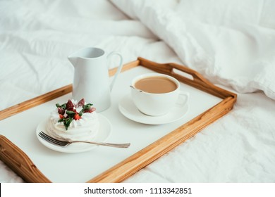 Cozy home breakfast in bed in white bedroom interior