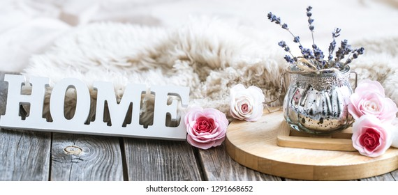 Cozy home composition on wooden background, home decor concept