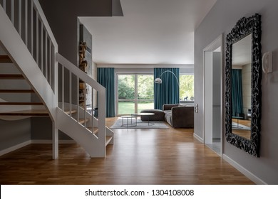 Cozy home interior with wooden stairs and open living room