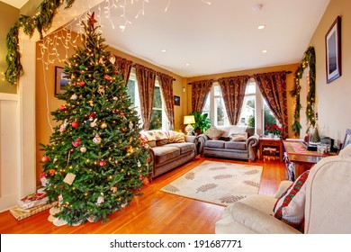 Cozy house interior on Christmas eve. View of living room with Christmas tree