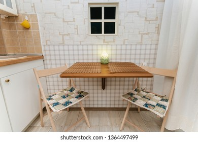 cozy kitchen folding chairs, a small table, a corner for two