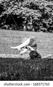 Cozy kite-flying on park lawn