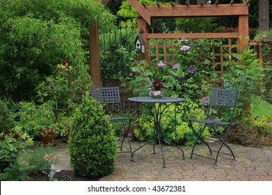 Cozy little back yard terrace with table and chair.