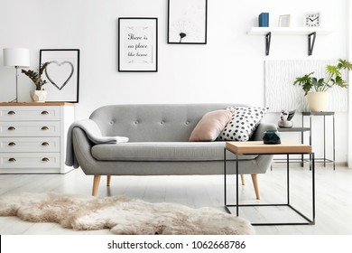 Cozy living room interior with comfortable sofa