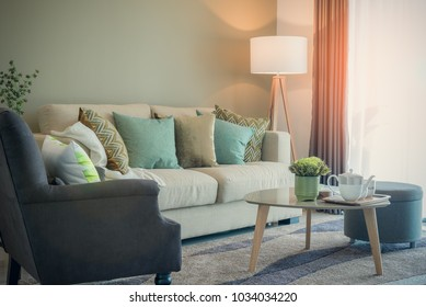 cozy living room with sety of tea cup on table, interior design concept
