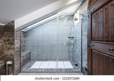 Cozy loft apartment, bathroom with glass shower