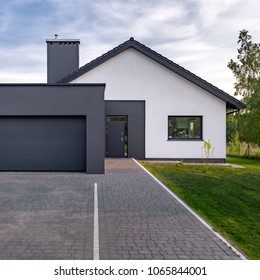 Cozy and modern house with garage and cobblestone driveway