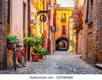 Cozy narrow street in Ferrara, Emilia-Romagna, Italy. Ferrara is capital of the Province of Ferrara - Shutterstock ID 1247082868