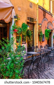 Cozy old street in Trastevere in Rome, Italy. Trastevere is rione of Rome, on the west bank of the Tiber in Rome, Lazio, Italy.  Architecture and landmark of Rome.