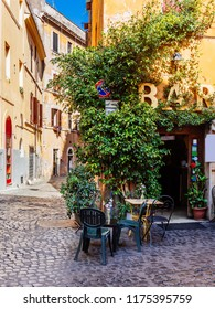 Cozy old street in Trastevere in Rome, Italy. Trastevere is rione of Rome, on the west bank of the Tiber in Rome, Lazio, Italy.  Architecture and landmark of Rome