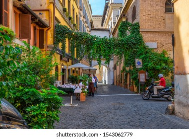 Cozy old street in Trastevere in Rome, Italy. Trastevere is rione of Rome, on west bank of Tiber in Rome. Architecture and landmark of Rome