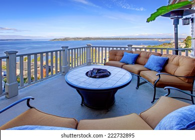 Cozy patio area with comfort settees and fire pit. Deck with Puget Sound view. Tacoma, WA